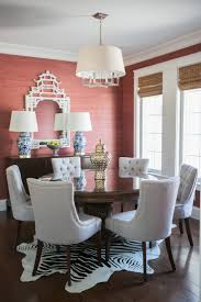 Elegant dining room features terracotta grasscloth wallpapered walls which  highlight a white pagoda mirror above a traditional buffet cabinet topped  with a ...