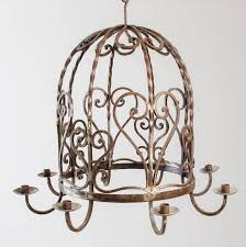 unusual birdcage shaped iron chandelier with eight candles heart and scroll motif repeated overall