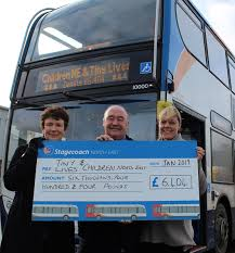 L to R – Pauline Holt (Children North East) and Louise Carroll (Tiny Lives)  were presented with a cheque from bus driver Dave Kenney (5) | North East  Connected