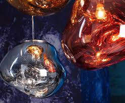 with melt our experiments in the technologically advanced field of vacuum metallisation takes on a new twist melt chrome is a distorted lighting globe