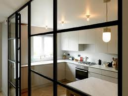 steel glass doors. In A Renovated Mews Home London, Steel Frame Wall By Crittal Replaced Glass Doors