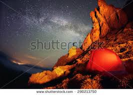 artistic lighting. artistic lighting unreal mountain scenery while rock climbing in the