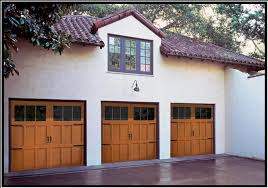 the series 300 carriage house collection are insulated steel constructed doors resembling the look of wood doors they are the first to offer a 3 section 7