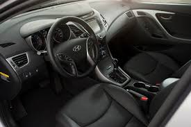 hyundai elantra interior 2014. key changes inside the 2014 elantra sedan include subtle revisions to air vent center stack control and armrest placements combined with a new hyundai interior