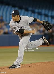 Hiroki Kuroda of the New York Yankees delivers a pitch in the first...  ニュース写真 - Getty Images