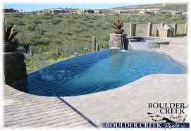 Negative edge pools Grass Pools Negative Edge Pool With Spa With Brick Paver Decking Boulder Creek Pools And Spas Negative Edge Pools Boulder Creek Pools And Spas