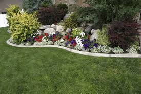 garden bushes. Shrubs Are A Great Accent To Other Features. This Landscape Has Rock And Flower Garden Bushes