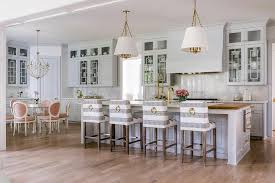 light gray island with marble and butcher block countertop