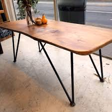 criss cross coffee table skid table made from reclaimed doors on a skid