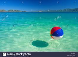 Beach ball in ocean Background Beach Ball Floating In Tropical Water Alamy Beach Ball Floating In Tropical Water Stock Photo 1394514 Alamy