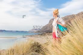 image of free happy woman enjoying sun on vacations