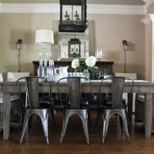 Wooden and metal chairs Contemporary Metal Cottage Dining Room With Metal Chairs Distressed Wood Table Footymundocom Photos Hgtv