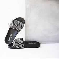 chanel slides. a less spoken about range of slides (but just as stylish) have to be the chanel slides. chain and leather look gives this pair touch grunge which