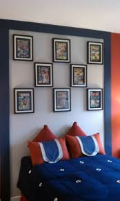 Framed comic book covers for son's room. Can be changed out as he matures or