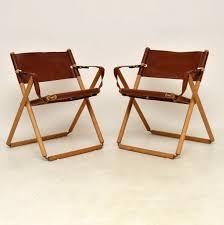 pair of vintage danish leather folding safari chairs