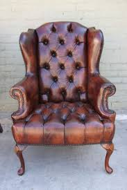 other pair of french leather tufted wingback chairs for