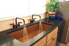 double faucet sink with a single basin for bathrooms