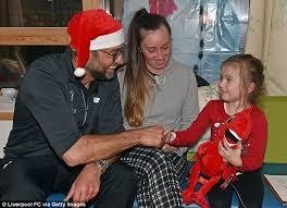 Liverpool manager jurgen klopp poses with no kids, no future banner amid ticket price ro. Jurgen Klopp And His Liverpool Squad Pay Visit To Children S Hospital Ahead Of Boxing Day Clash With Stoke Daily Mail Online