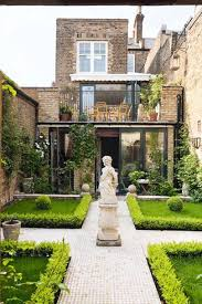 this townhouse garden off portobello road provides a sanctuary from the bustling streets of notting hill with the dining area situated on the roof terrace