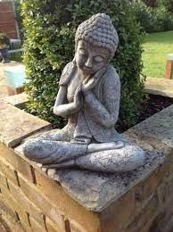 resting buddha statue cast stone garden