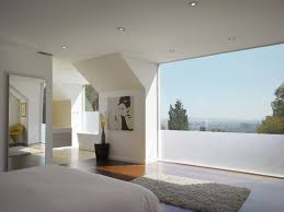 Example of a small minimalist master dark wood floor bedroom design in Los  Angeles with white