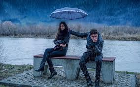 Boy and girl in the rain