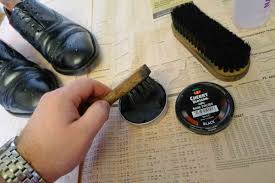 next i like to apply wax to the rest of the upper of the shoe along with the sides of the sole and heel with a soft cloth