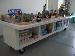 great looking white train table ideas for play kids with white book storage and white wall paint idea