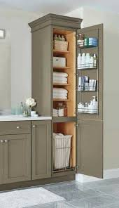 a linen closet with four adjule shelves a chrome door rack and a pull out hamper