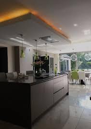 chandelier over kitchen island lowered ceiling over kitchen island by annabelle tugby architects