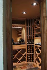 view into a small wine room showing vint unfinished pine wine racking components