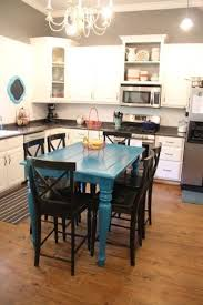 thrifty turquoise dining table redo before and after easy diy that changes the whole kitchen like the concept of a pow of colour find something