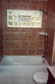 glass block window in shower tub and shower with tiled walls glass block window and a glass block window in shower