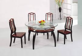dining room maroon accent on wooden two layer glass dining table set and fruits