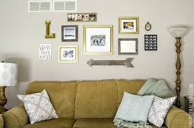 living room gallery wall above the sofa living room gallery walls great ideas including a pallet living room gallery wall