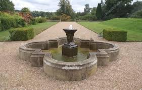 scoteney castle fountain in garden england stock photo