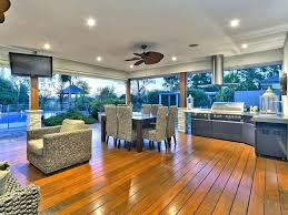 fully equipped outdoor entertaining area overlooking the pool stunning indoor outdoor rubber flooring indoor outdoor floor