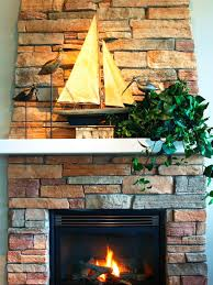 istock 04515850 stone fireplace sailboat on mantel s3x4