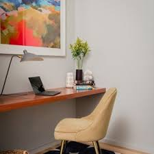 small home office. Example Of A Small Coastal Built-in Desk Light Wood Floor Study Room Design  In Home Office