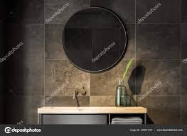 bathroom sink mirror hanging black tiled wall concept interior design stock photo