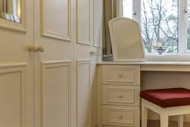 Fitted bedrooms small space Bedroom Unit Close Up Of Cream Fitted Wardrobe Run And Adjoining Dressing Table With Freestanding Mirror And Stool Hartleys Bedrooms Spacesaving Tips For Small Bedrooms From Hartleys Rooms