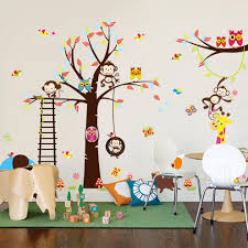 attractive kids wall decor in the theme of monkey in the jungle hanging in the trees also with other animals completed with kids furnitures and education