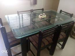 glass wood dining table with price. image 1 glass wood dining table with price