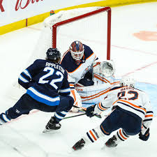 Edmonton oilers goaltender mike smith (41) makes a save on a winnipeg jets shot as players look for the rebound during the first period of an nhl game against the winnipeg jets, in winnipeg. Izr 250auzm4fm