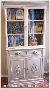 wood furniture appliques. fabulous refinishing of a vintage book cabinet love the added wood appliques trim and furniture