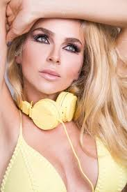 portrait of a very beautiful blond hair woman in y yellow dress with yellow headphones around