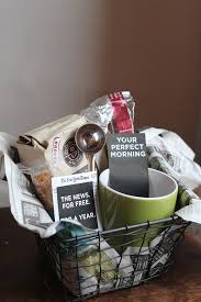 perfect morning gift basket a hot beverage mug spoon biscotti book giftcard or magazine newspaper subscription all wrapped up in a wire basket