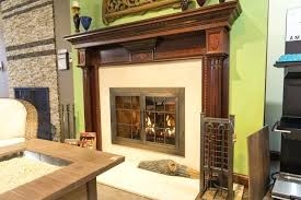 gas fireplace with wood surround and glass doors parts of a