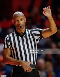 NCAA basketball official Lewis Garrison is seen during the Illinois... News  Photo - Getty Images
