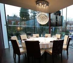 panache premier indian dining round table under the chandelier for 10 people
